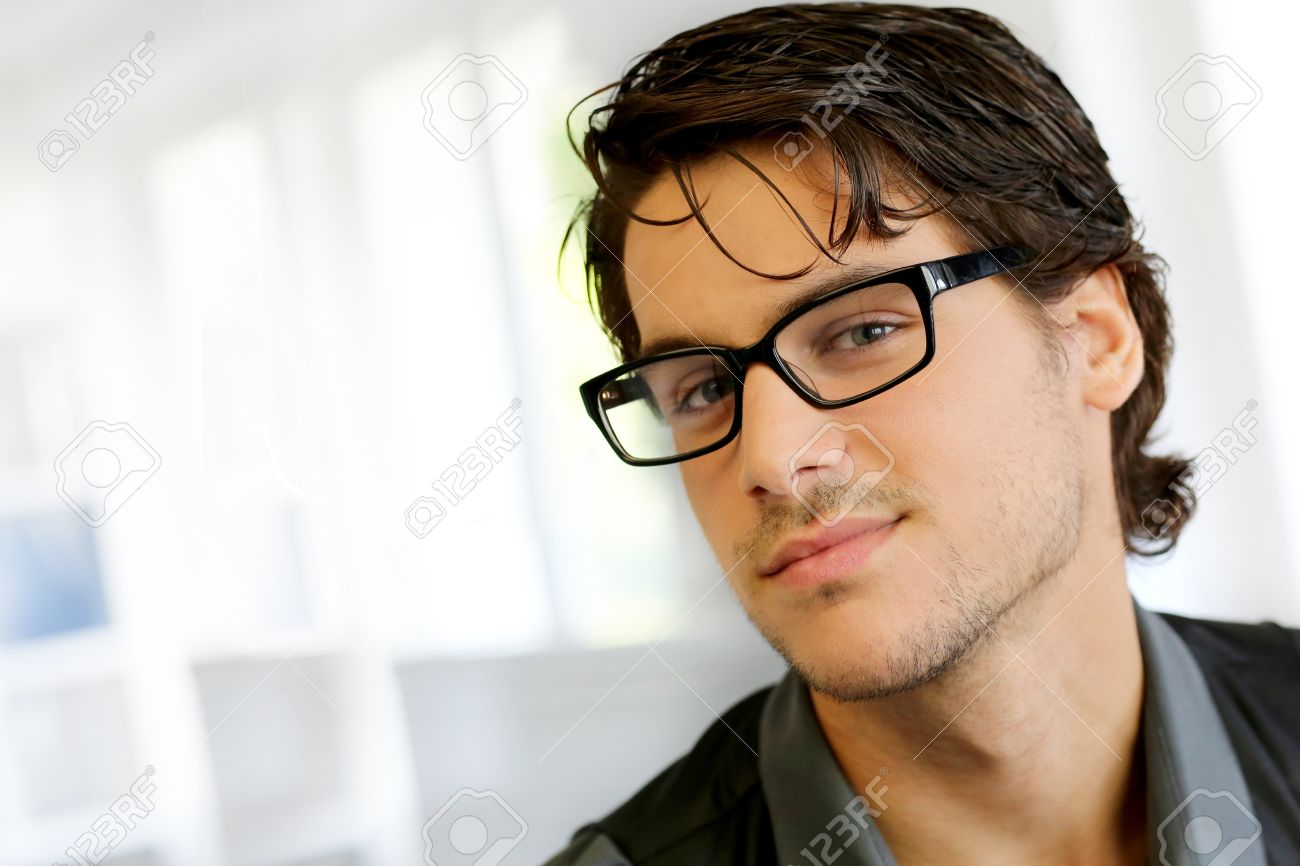 d547df9a47a Portrait of handsome young man with glasses Stock Photo - 15278213