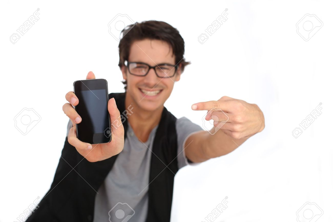 Young man showing smartphone screen to camera Stock Photo - 15383624