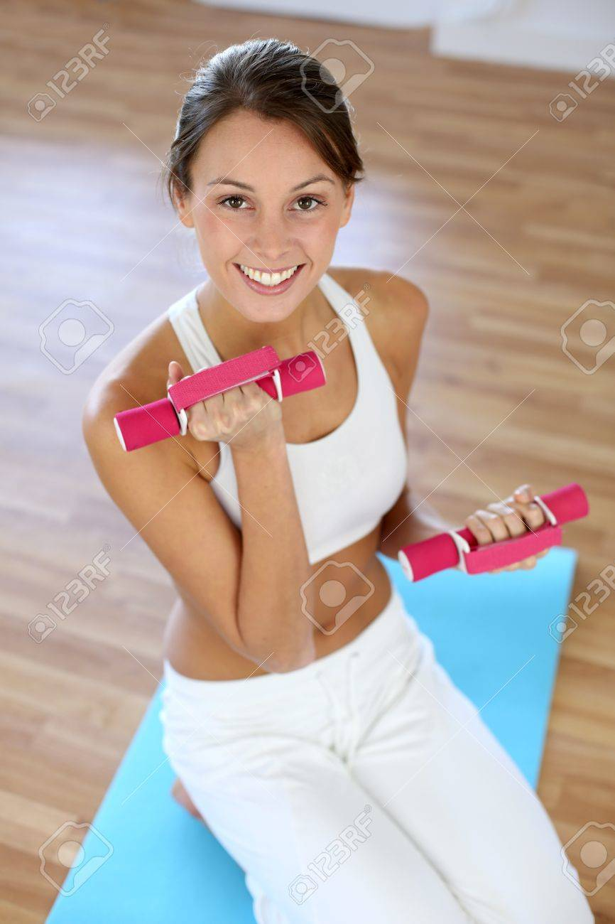 Fitness girl lifting dumbbells in gym Stock Photo - 15638044