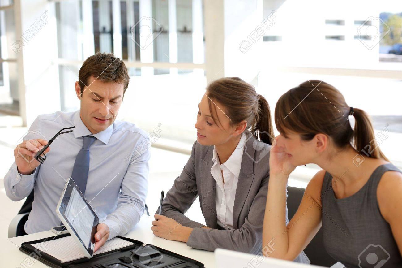 Business presentation around table Stock Photo - 15811181
