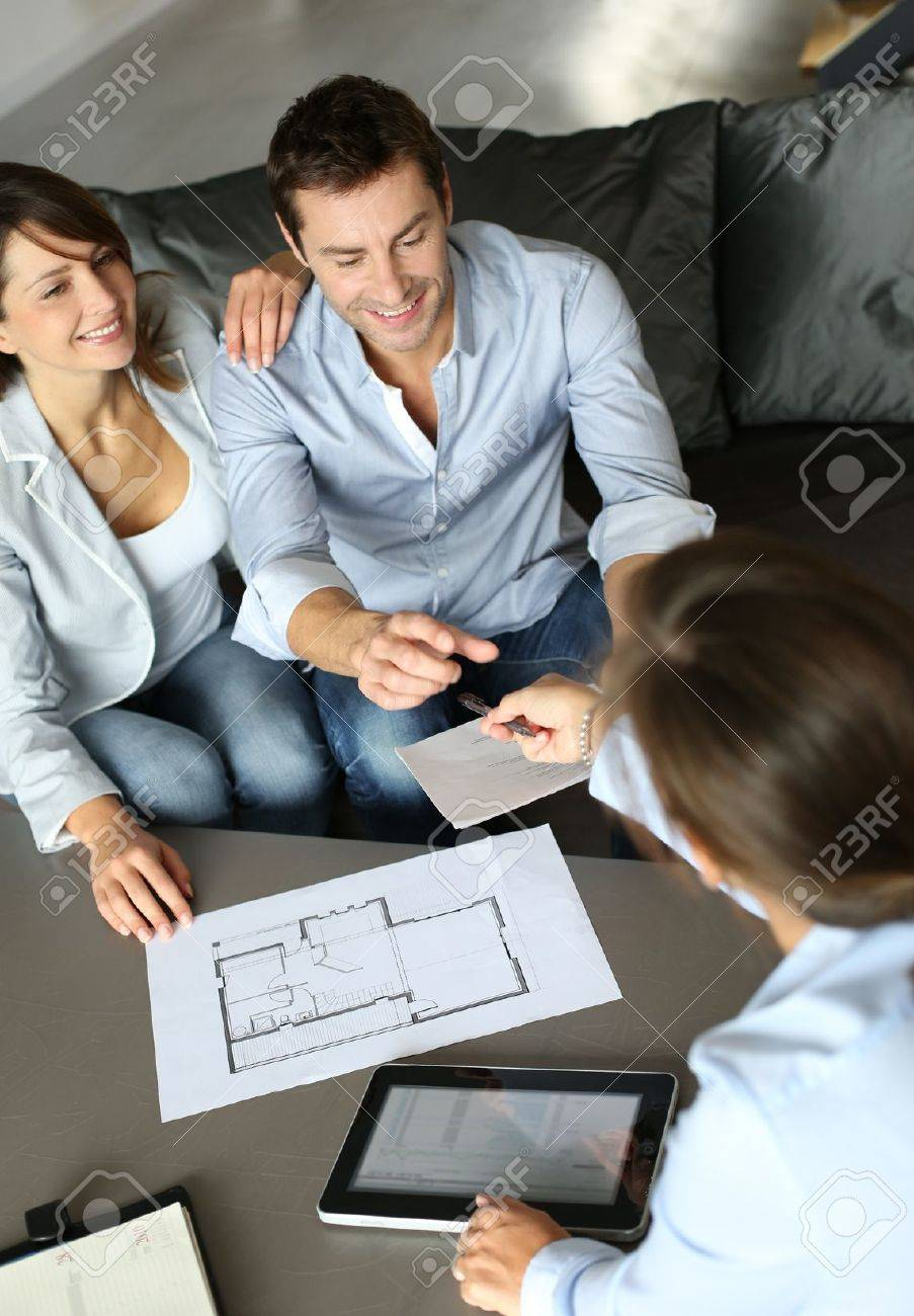 Couple signing financial terms for future property Stock Photo - 15831920
