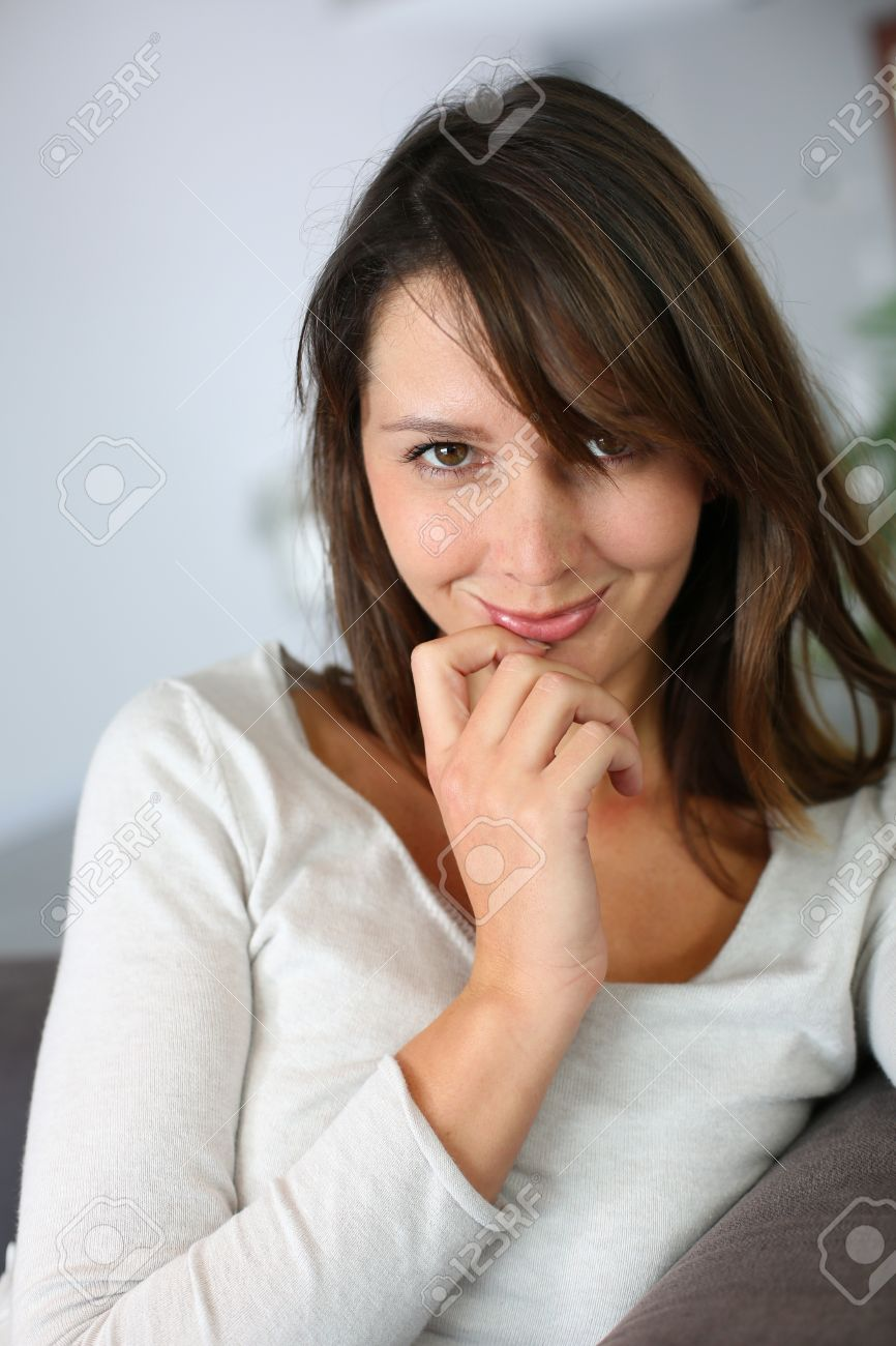 Attractive brunette girl looking at camera Stock Photo - 15831989