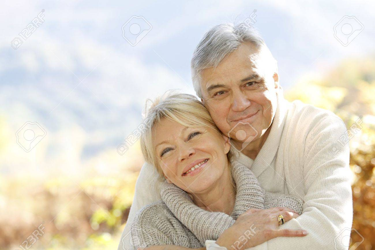 Senior couple embracing each other in countryside Stock Photo - 16322256