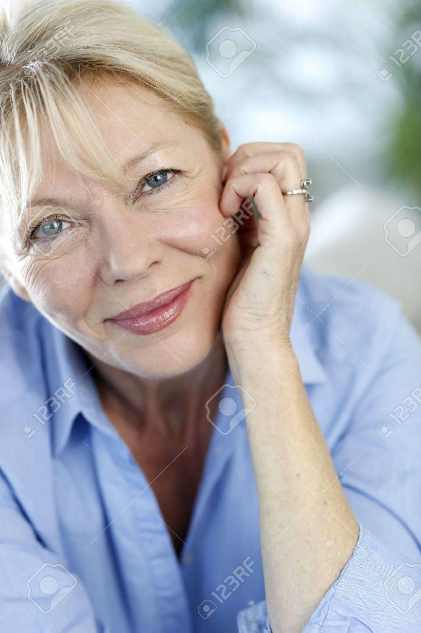 Closeup of senior woman with blue shirt Stock Photo - 16398495