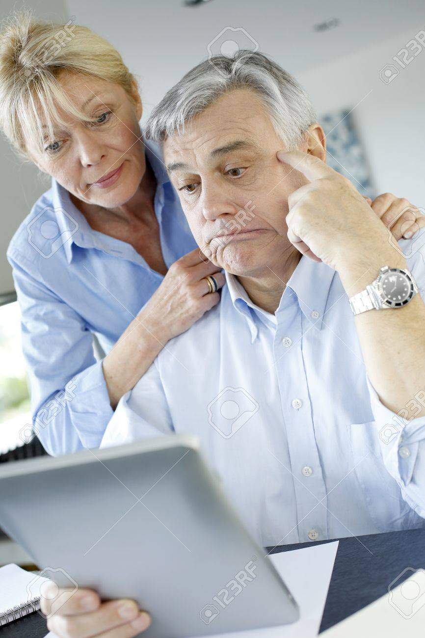Senior couple trying to figure out tax declaration Stock Photo - 16398526
