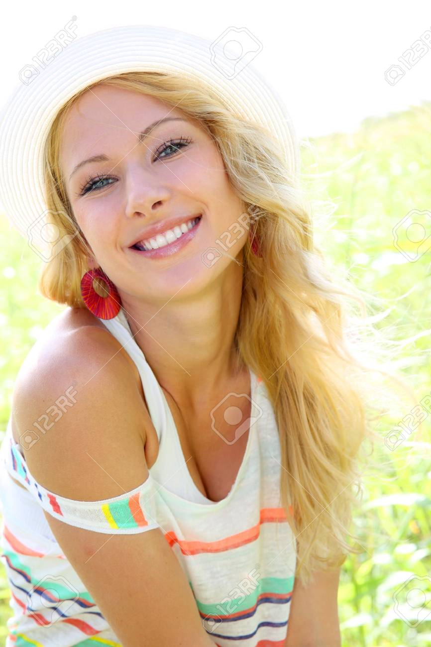 Beautiful blond girl in countryside Stock Photo - 17161299