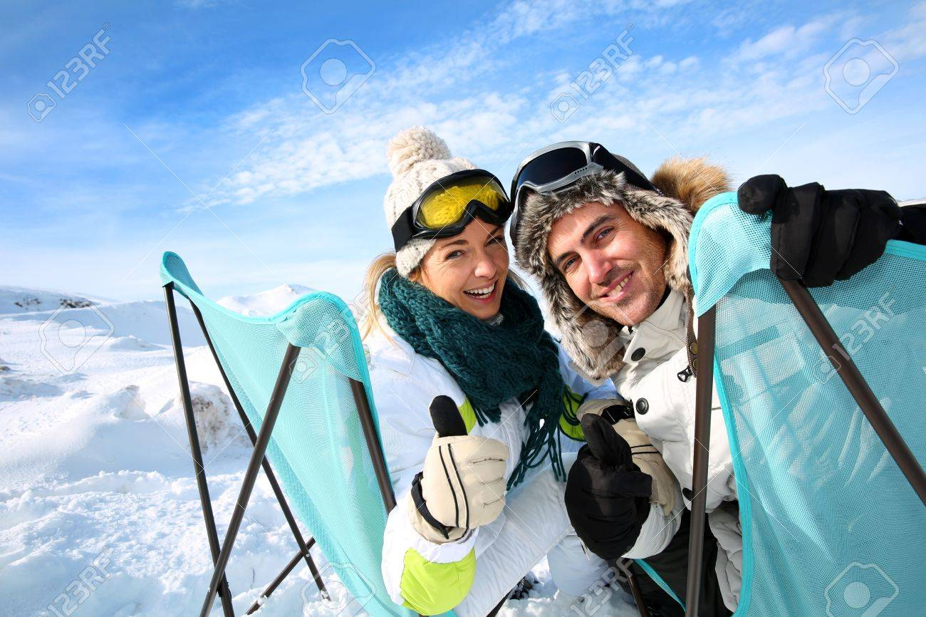Portrait of skiers sitting in long chairs Stock Photo - 17801751