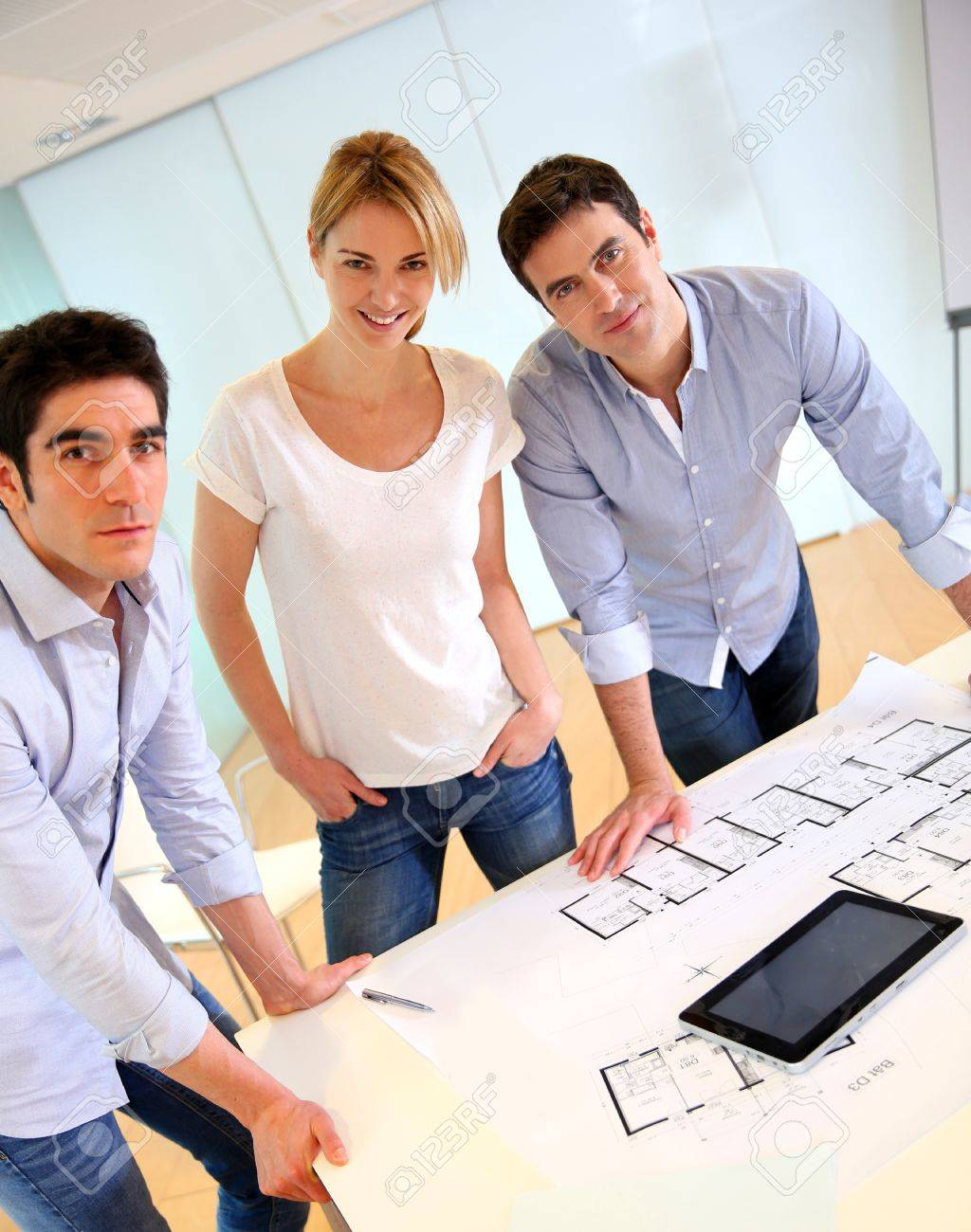 Group of architects working in office Stock Photo - 17826079
