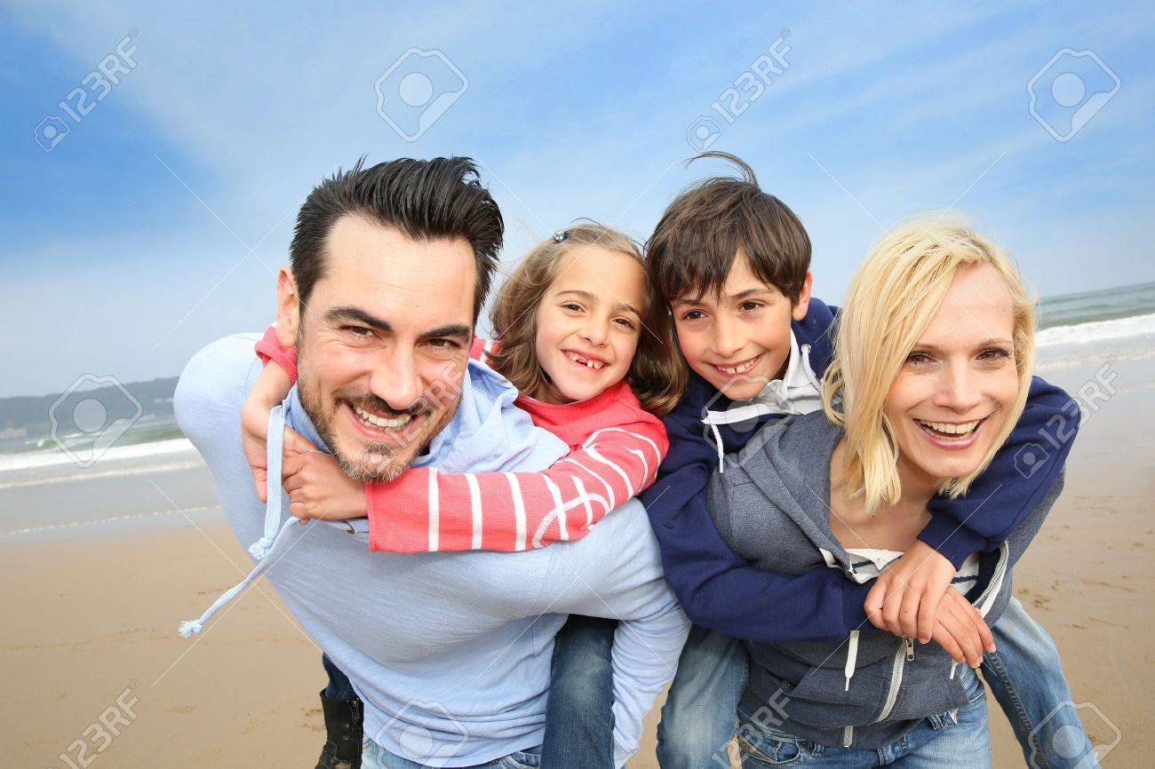 Portrait of cheerful family at the beach Stock Photo - 18919075