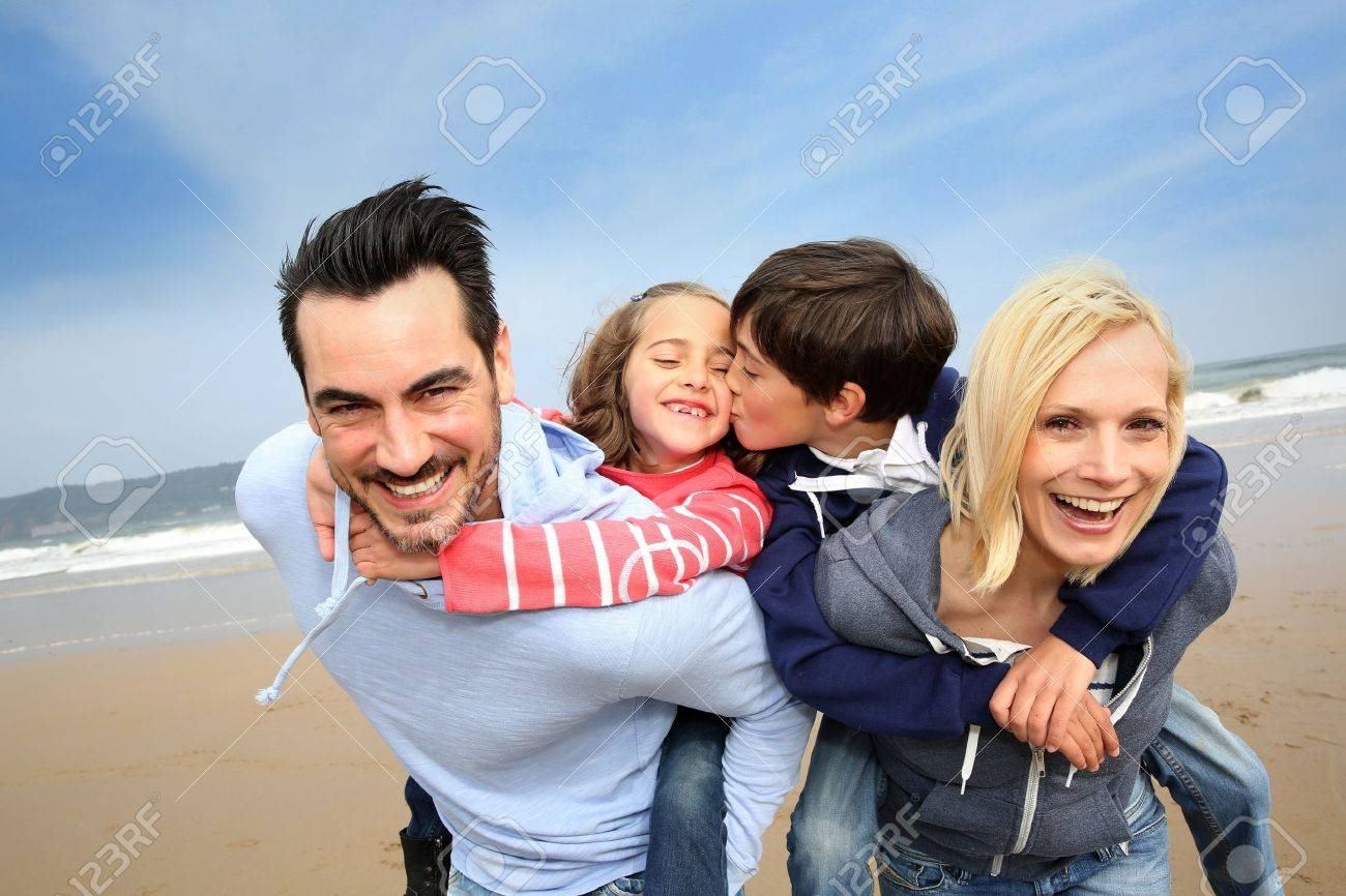 Portrait of cheerful family at the beach Stock Photo - 18919077