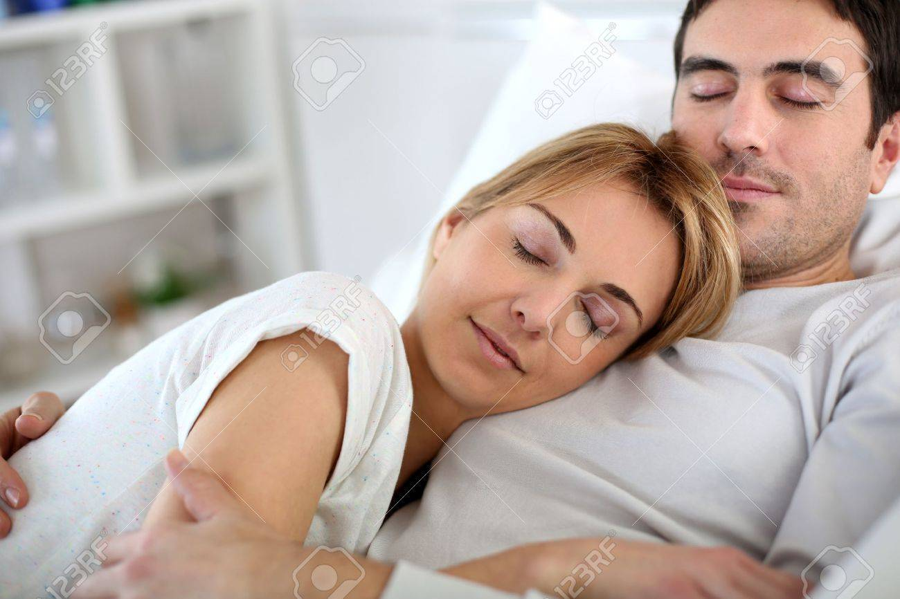 Couple taking a nap in sofa at home Stock Photo - 18918960