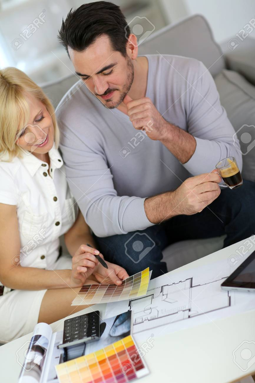 Couple looking at paint colors for new home Stock Photo - 18918490