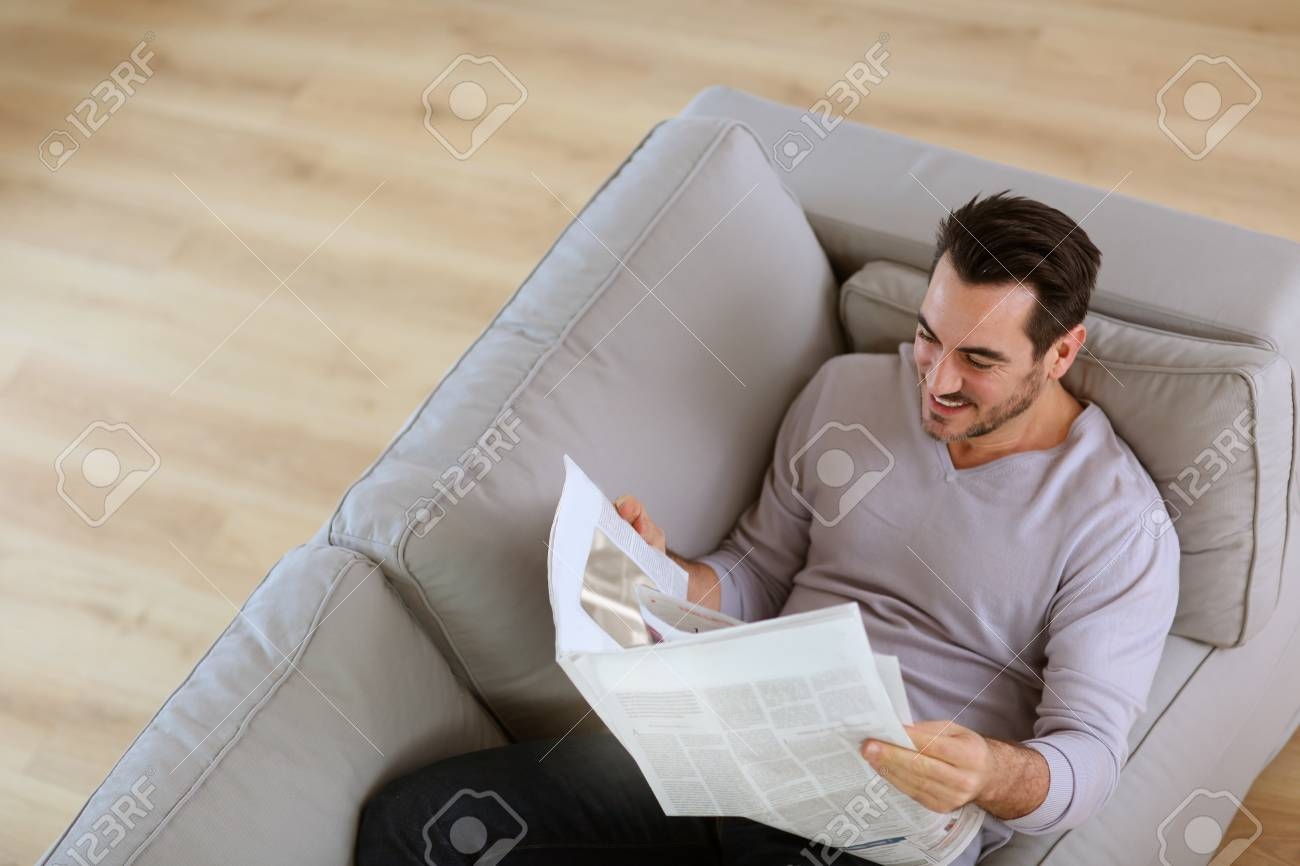 Upper view of man reading newspaper in sofa Stock Photo - 18902220