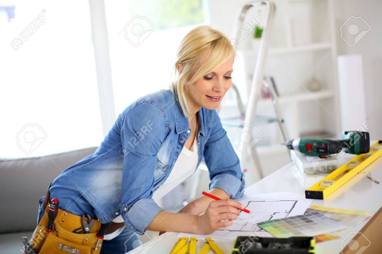 woman working on home improvement planning stock photo, picture