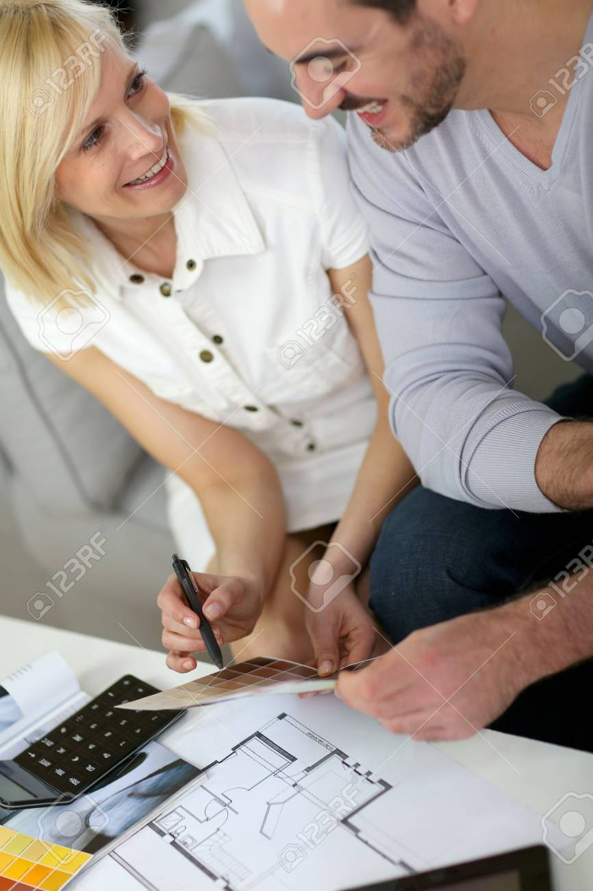 Couple looking at paint colors for new home Stock Photo - 18939590