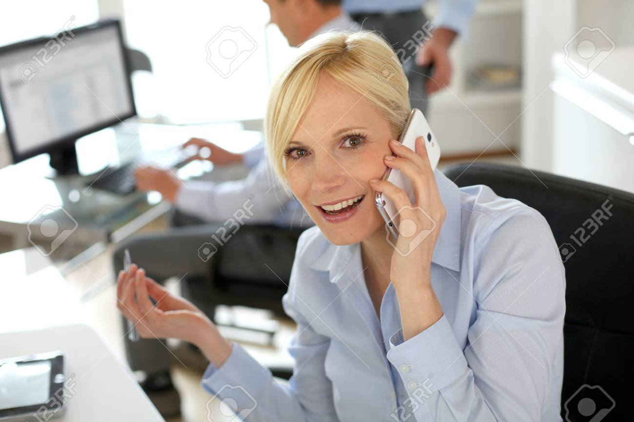 Businesswoman on the phone taking note on agenda Stock Photo - 18939573