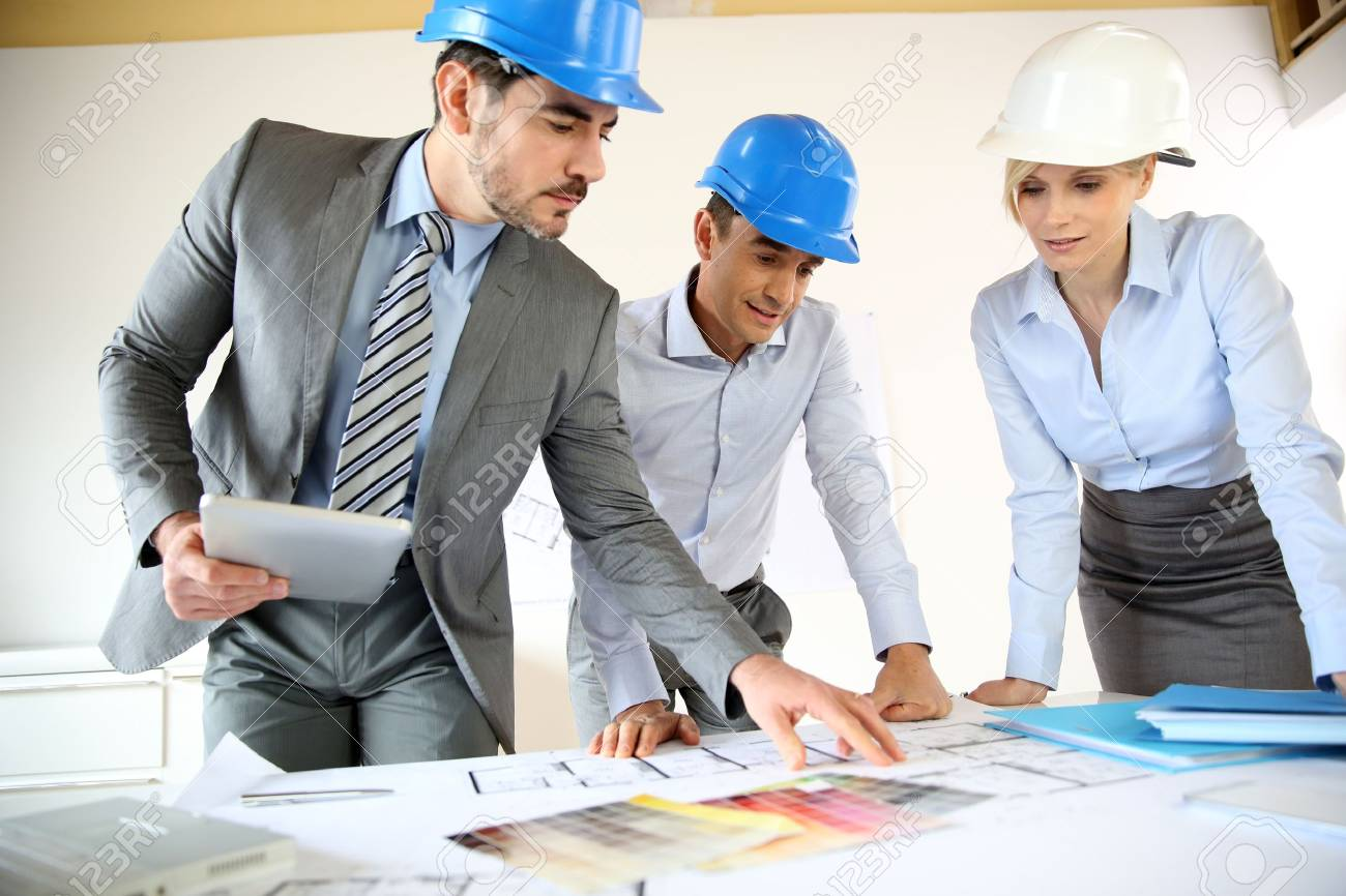 Team of architects presenting construction project Stock Photo - 18939493