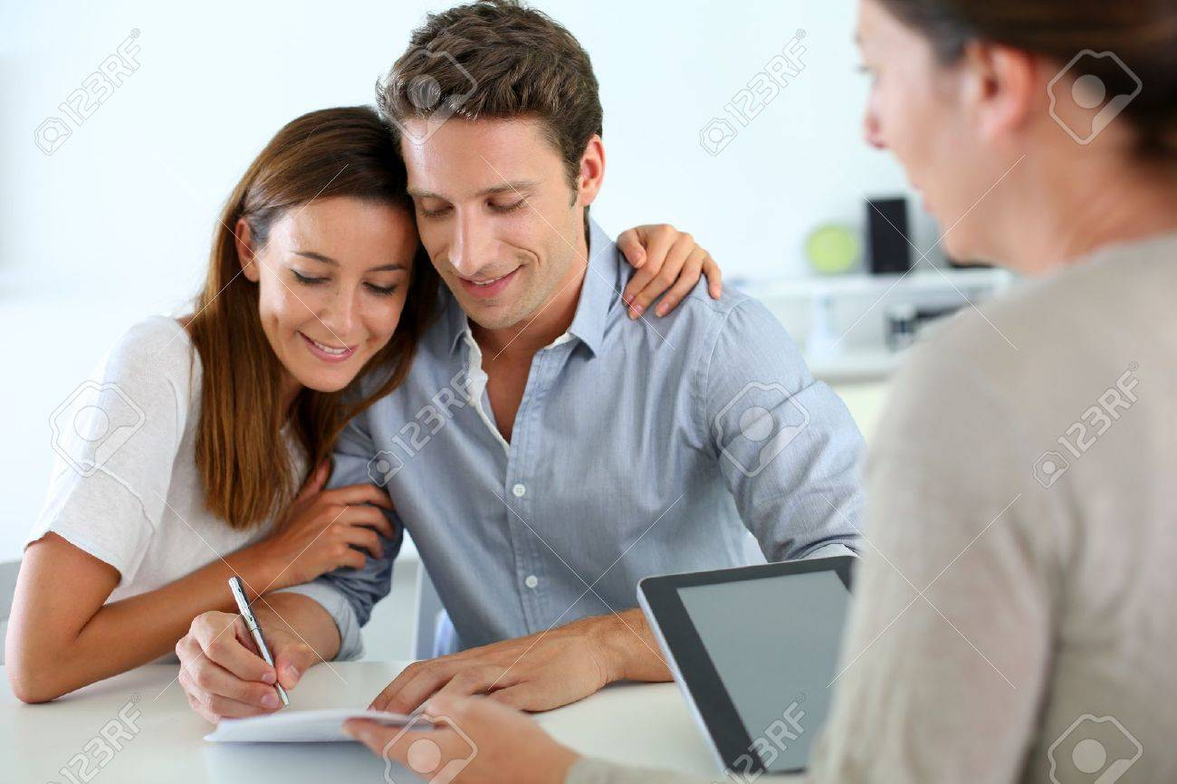 Couple signing real-estate contract Stock Photo - 19269947