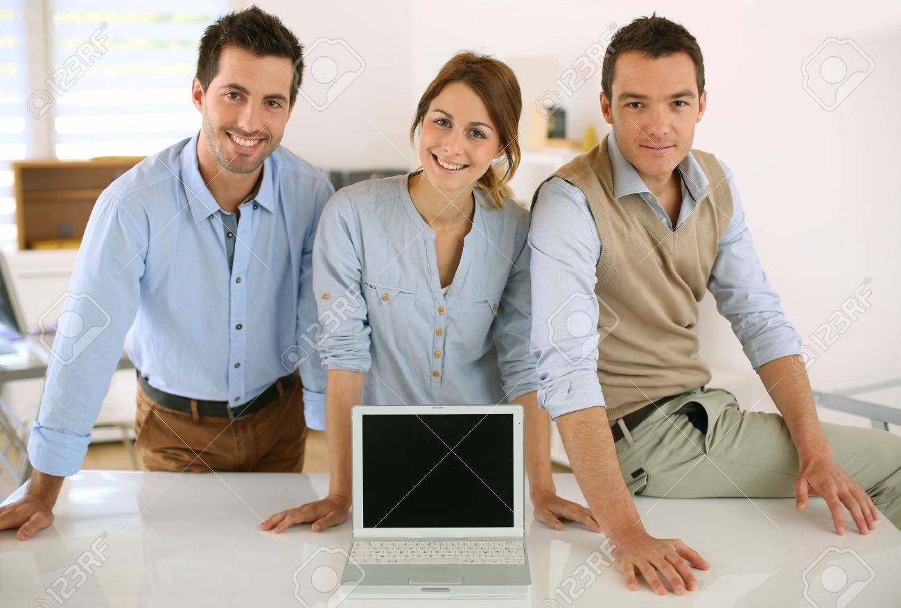 Successful startup people showing laptop screen Stock Photo - 20190118