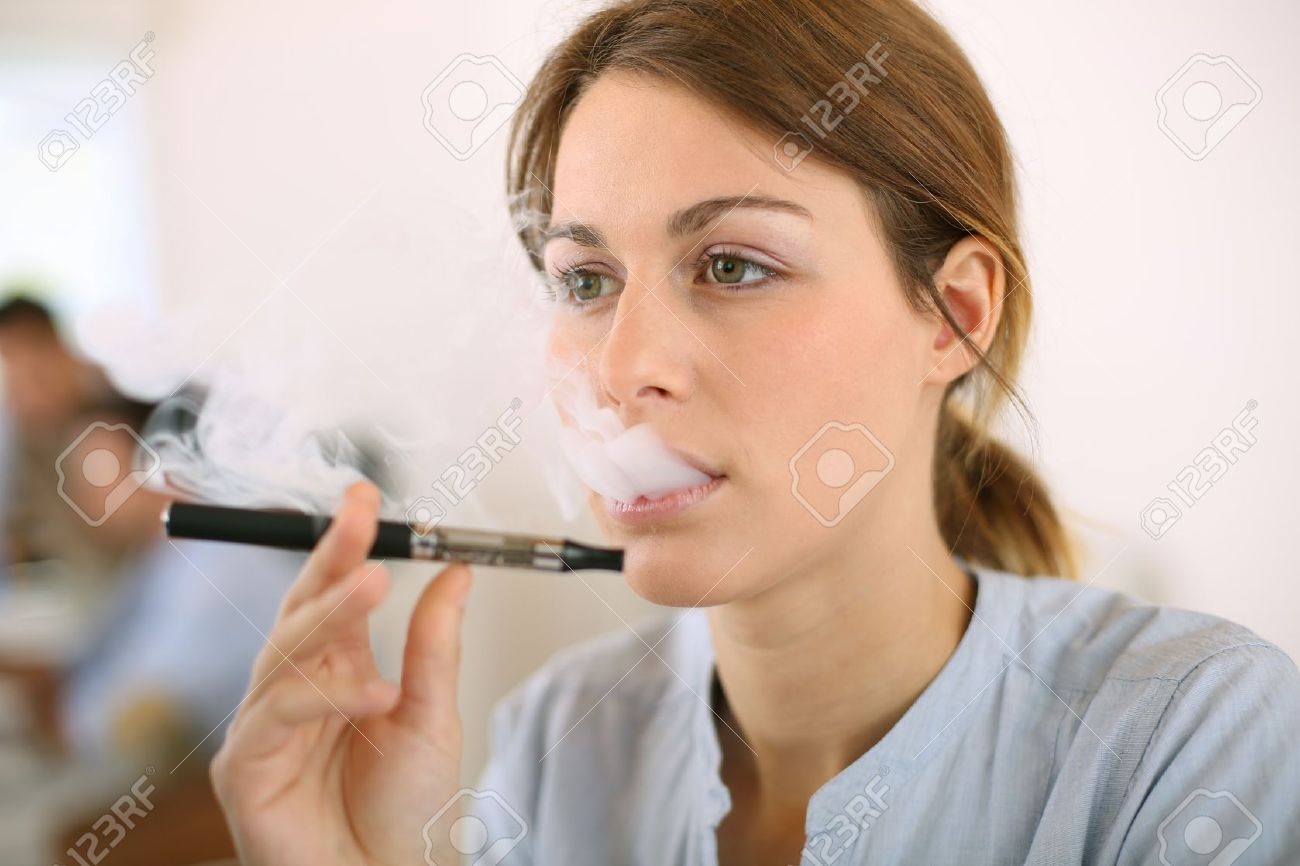 Portrait of woman smoking with electronic cigarette Stock Photo - 20199454