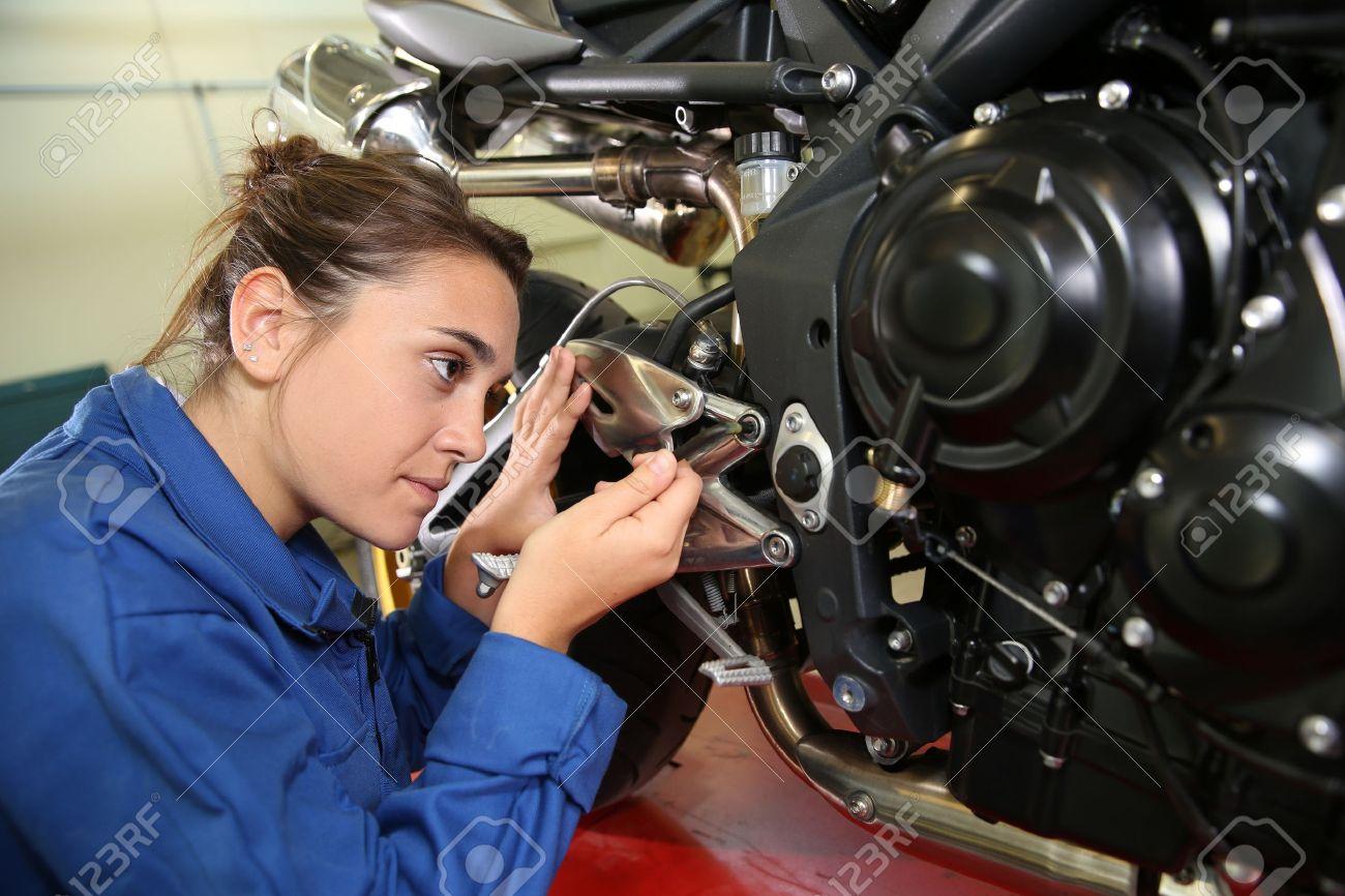 stock photo student girl in motorbike mechanics