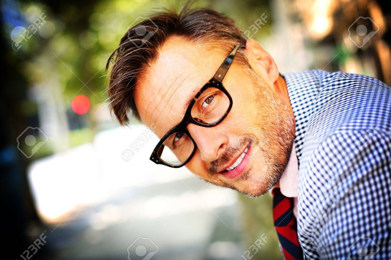 trendy eyeglasses ysgm  Portrait of trendy guy with eyeglasses and tie Stock Photo