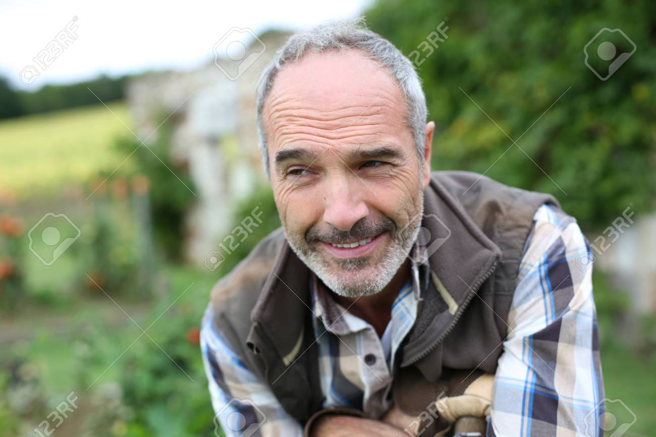 Portrait of senior gardener in vegetable garden Stock Photo - 22394803