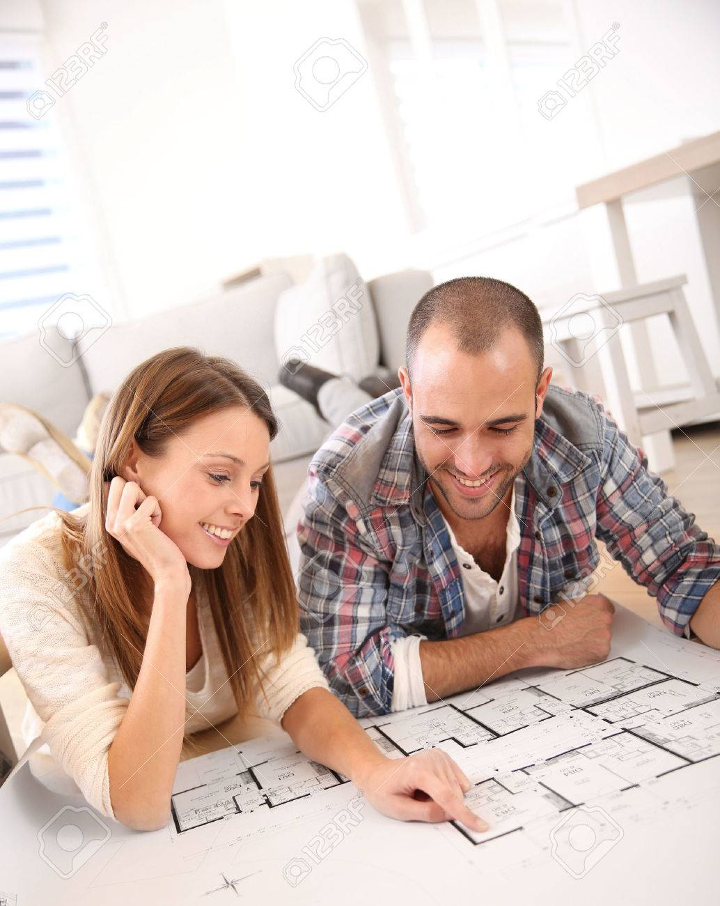 Cheerful Couple Looking At Construction House Plan Stock Photo    Stock Photo   Cheerful couple looking at construction house plan