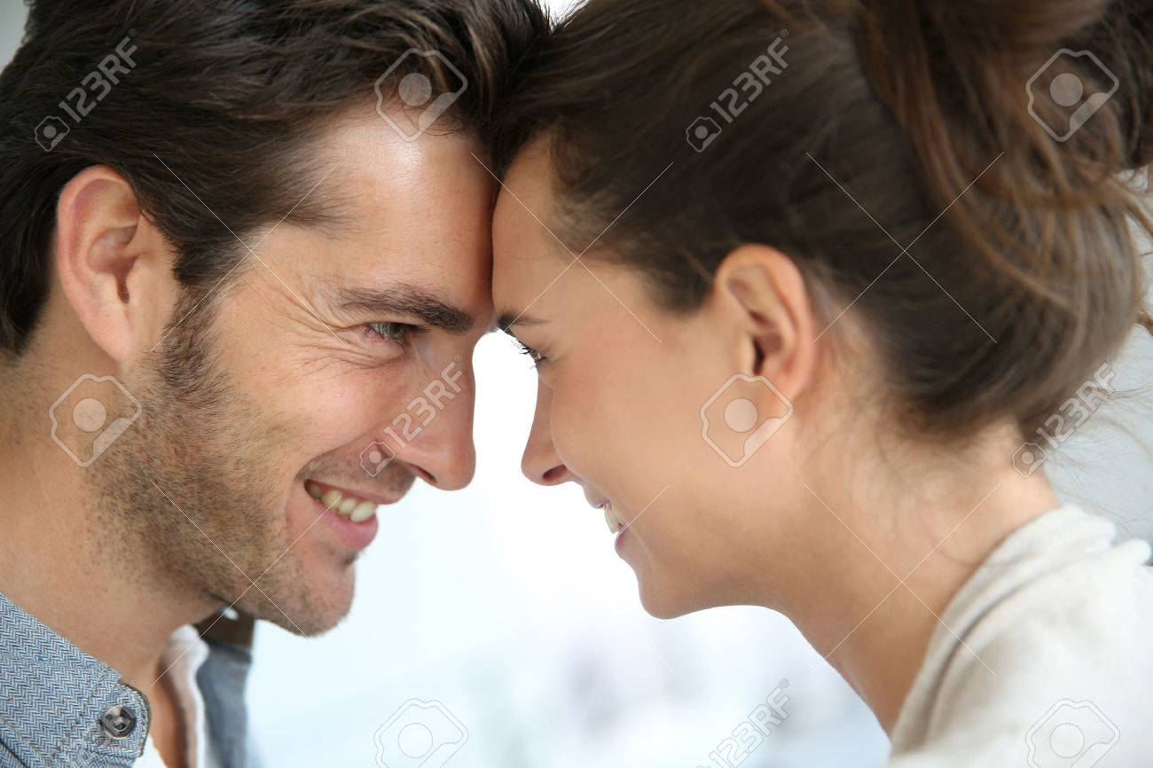 Profile of loving couple looking at each other Stock Photo - 23365492