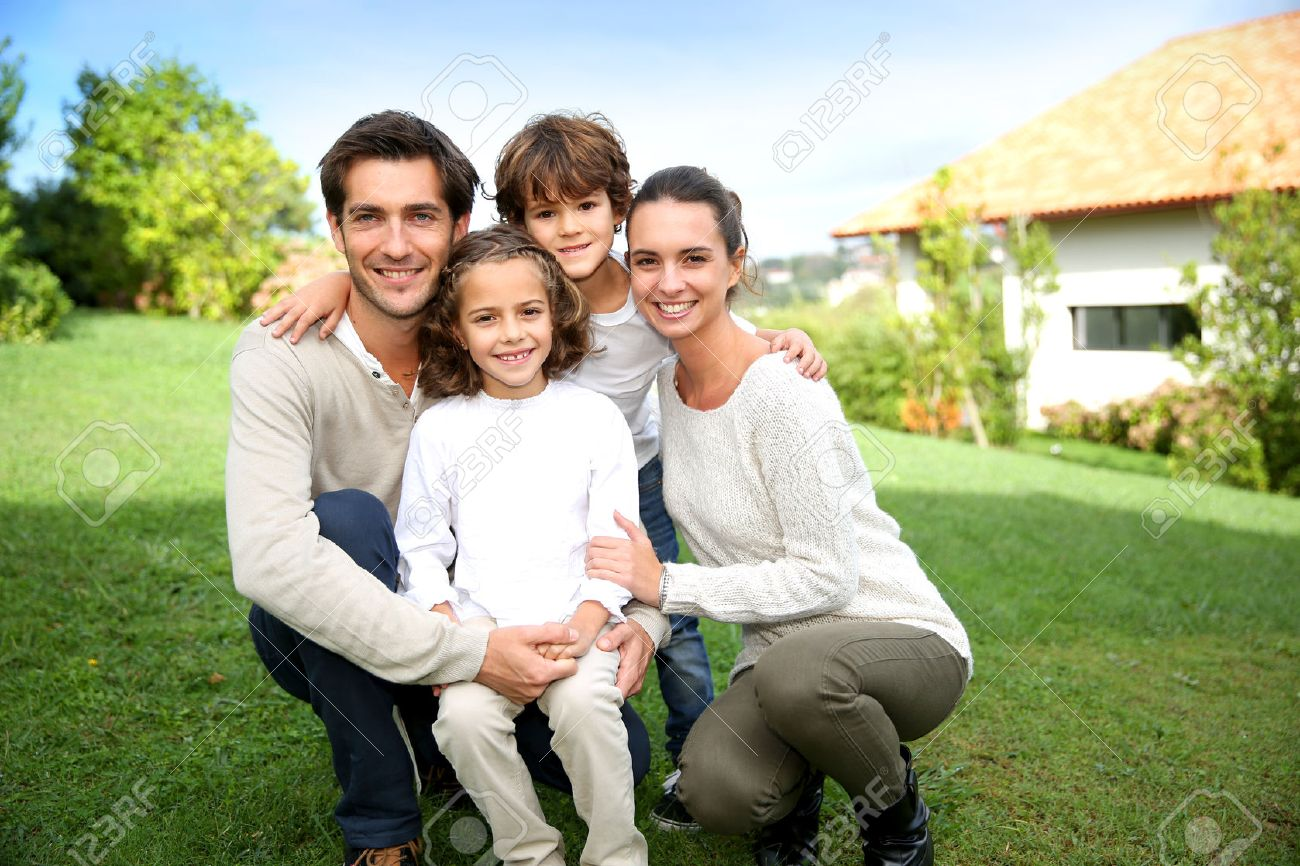 Cute family portrait of 4 people stock photo 23365241