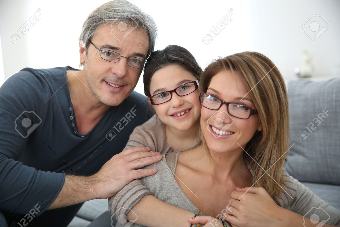 Portrait of family of 3 people wearing eyeglasses Stock Photo - 25910020