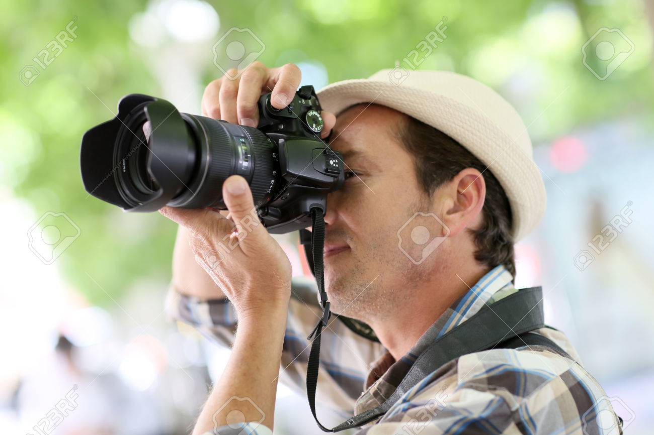 Professional grapher In Town Taking Stock