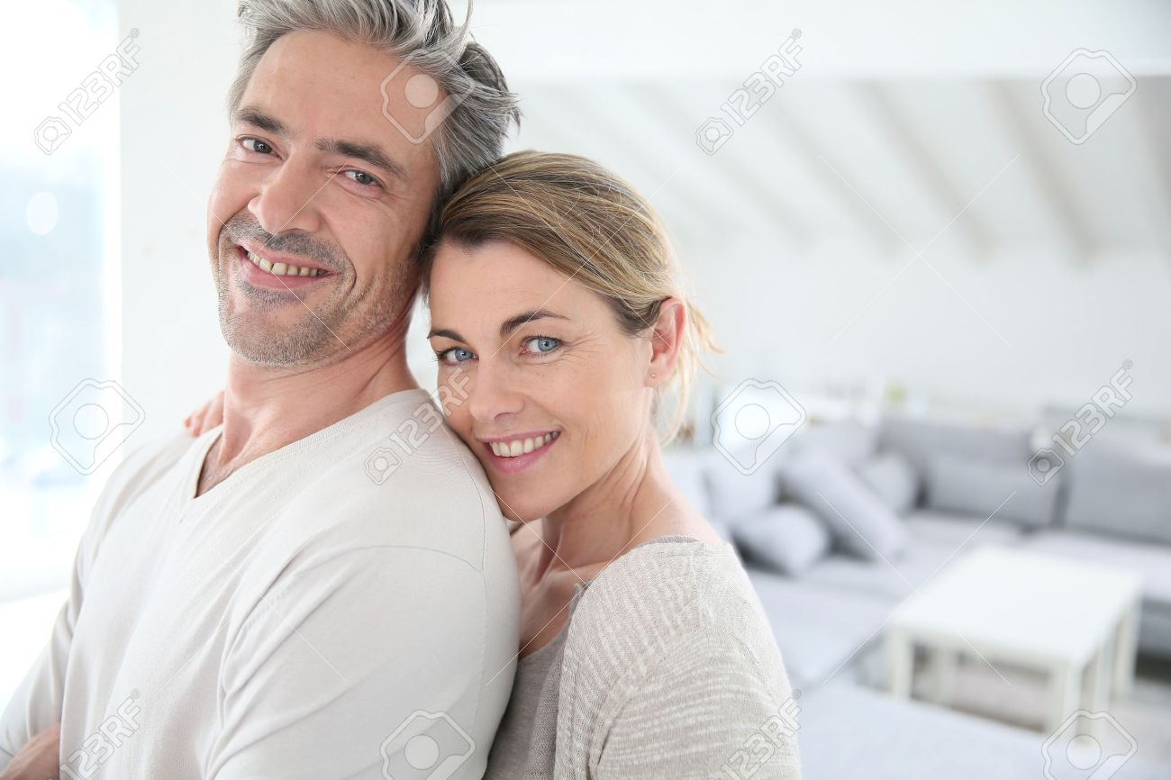 Couple Mature happy mature couple in brand new home stock photo, picture and