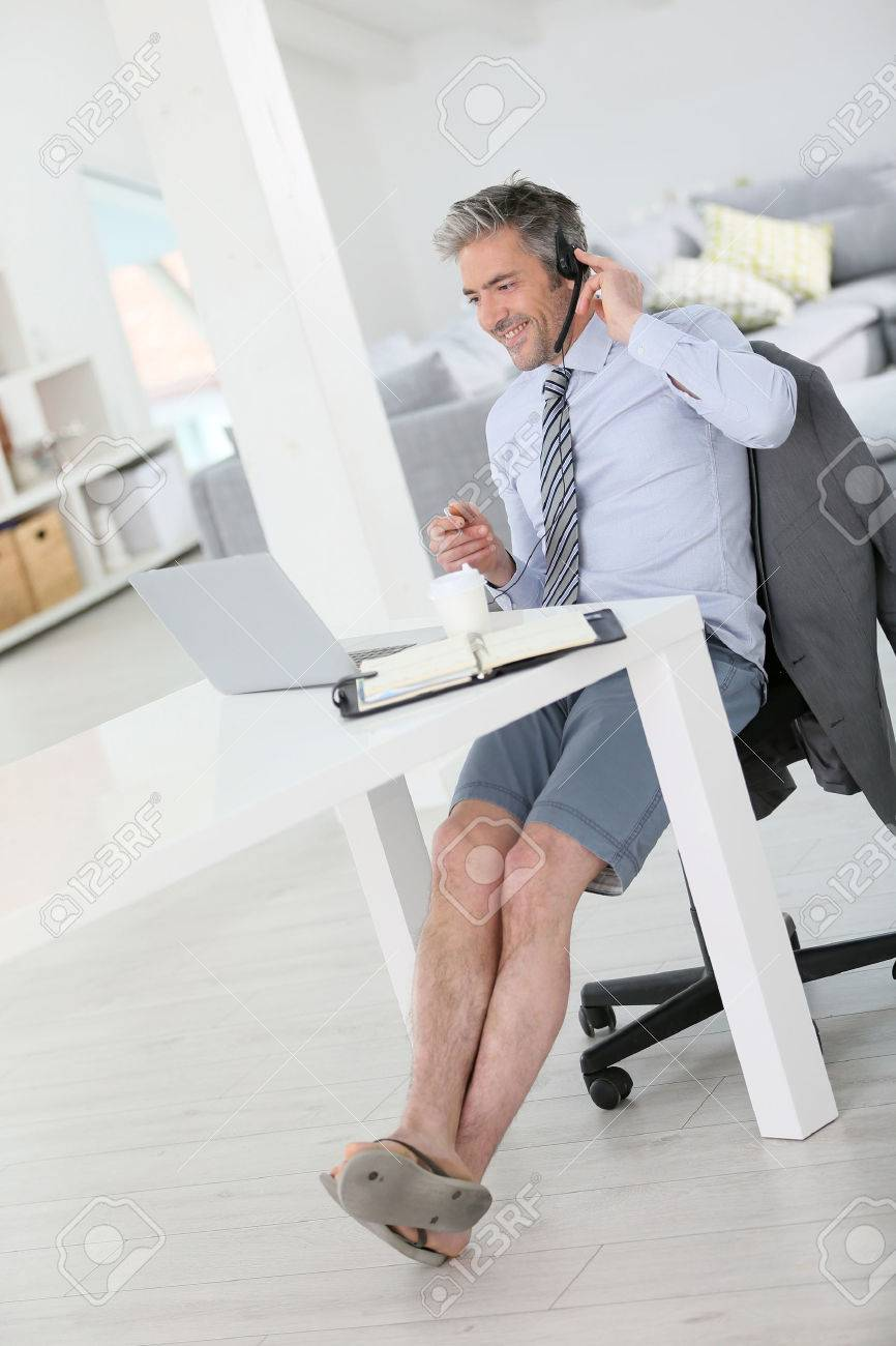Businessman On Video Meeting From Home In Relaxed Outfit Stock ...