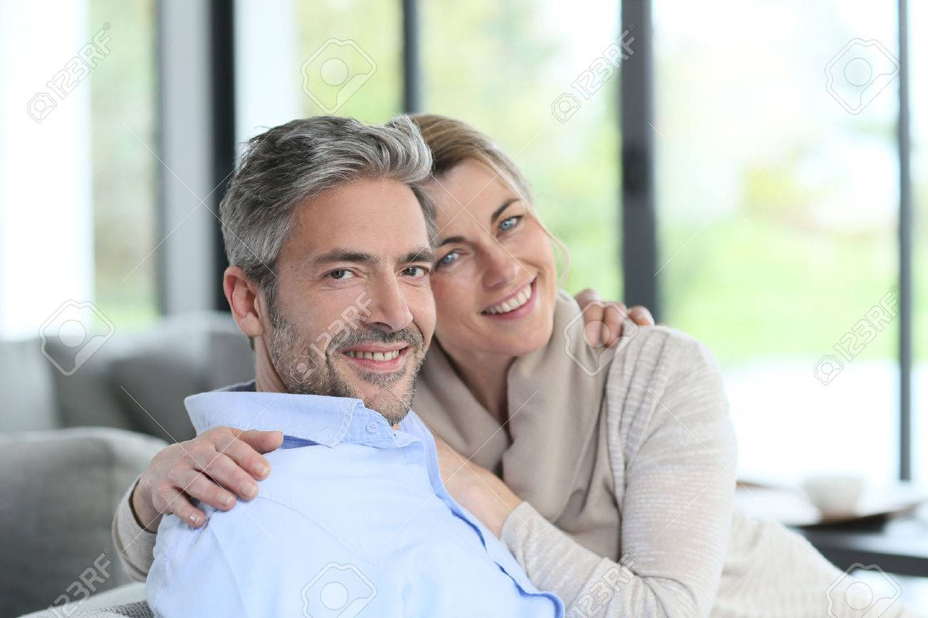 Couple Mature portrait of mature couple relaxing at home stock photo, picture and