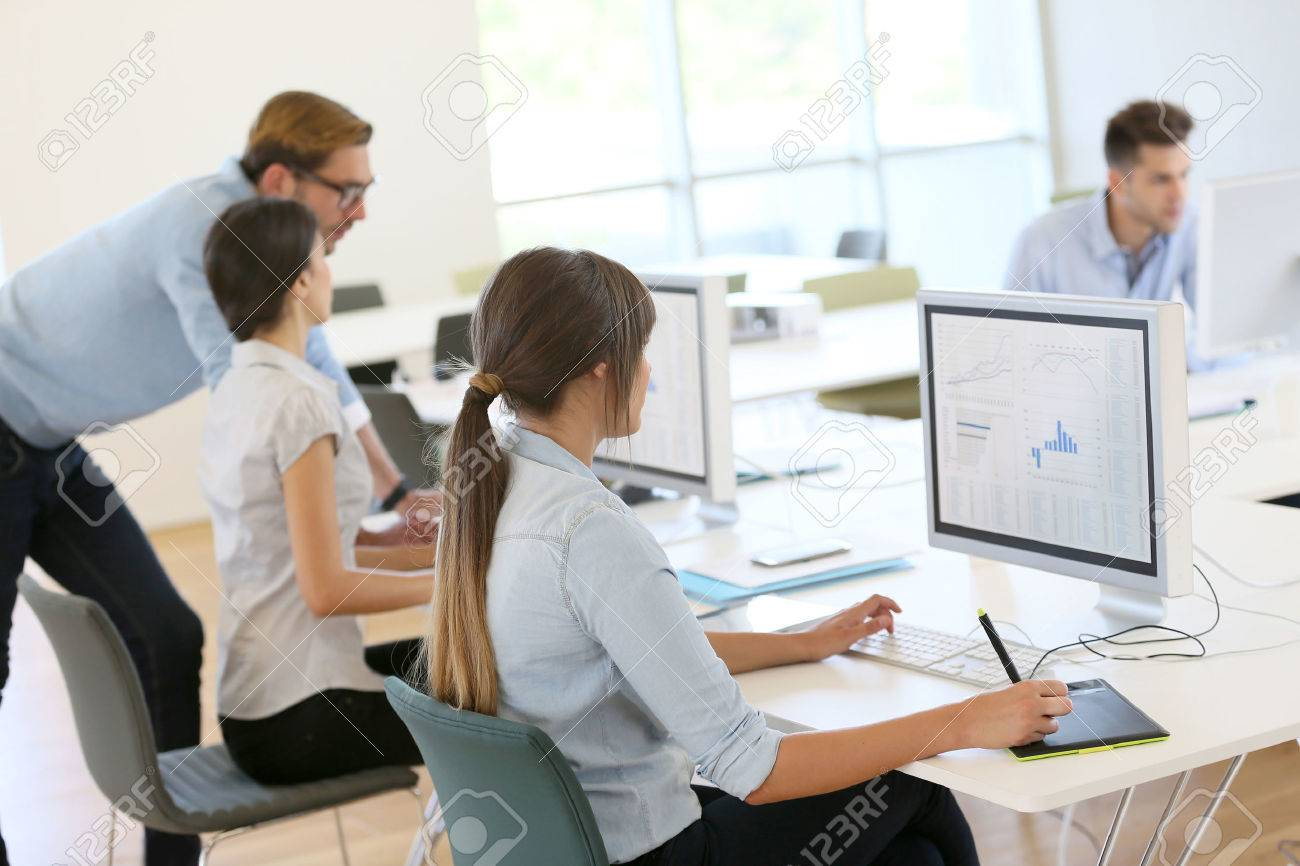 Creative people working in office on computer - 40900407