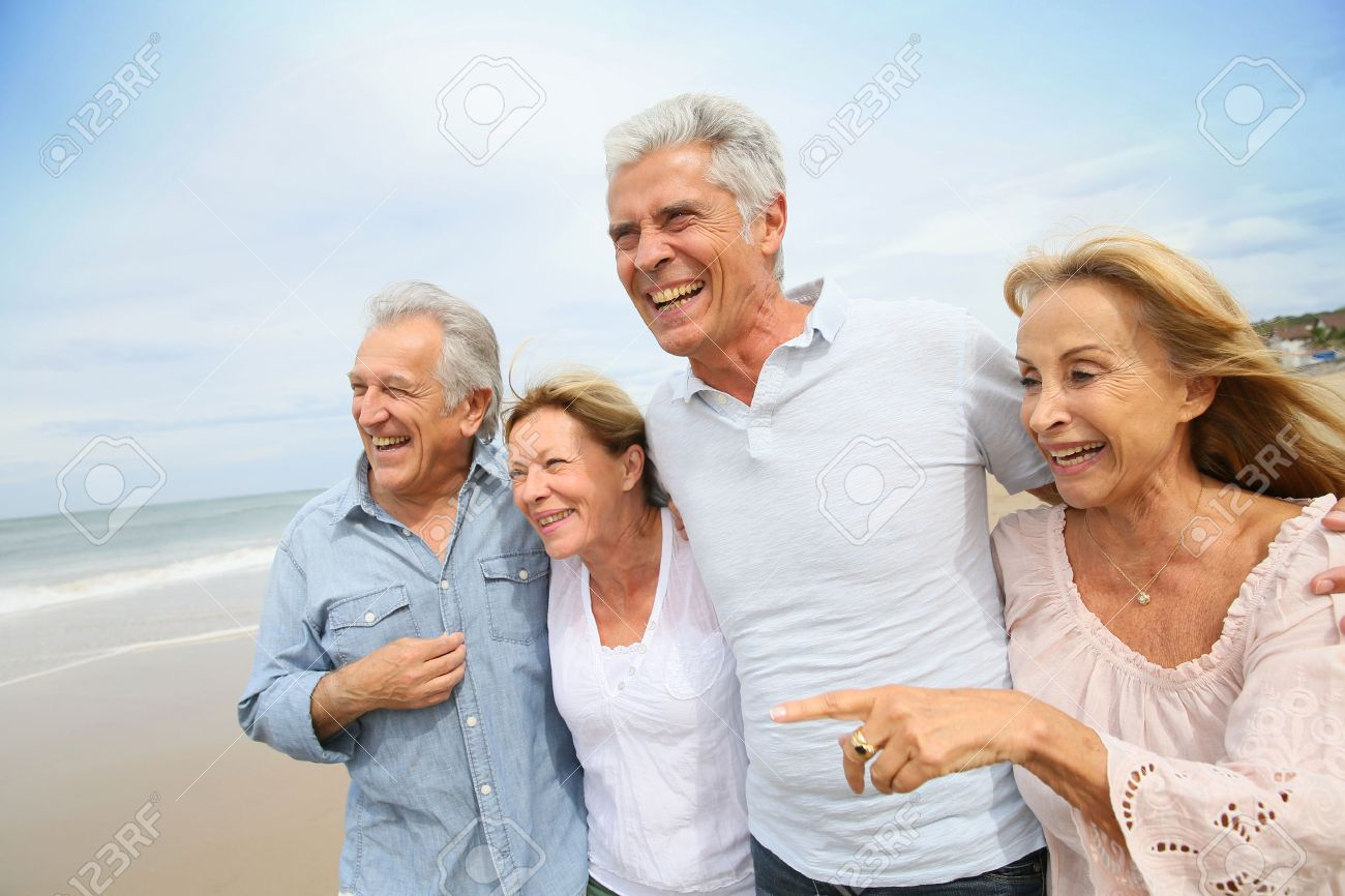 Senior people walking on the beach Stock Photo - 45367049
