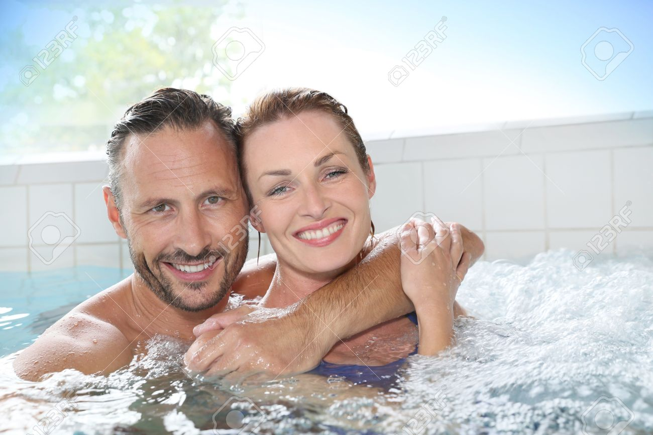Couple Enjoying Hot Tub Bath In Spa Center Stock Photo, Picture And ...