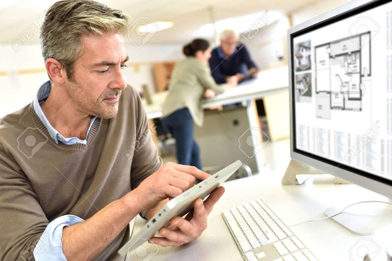 Engineer working in design office on desktop computer Standard-Bild - 50630812