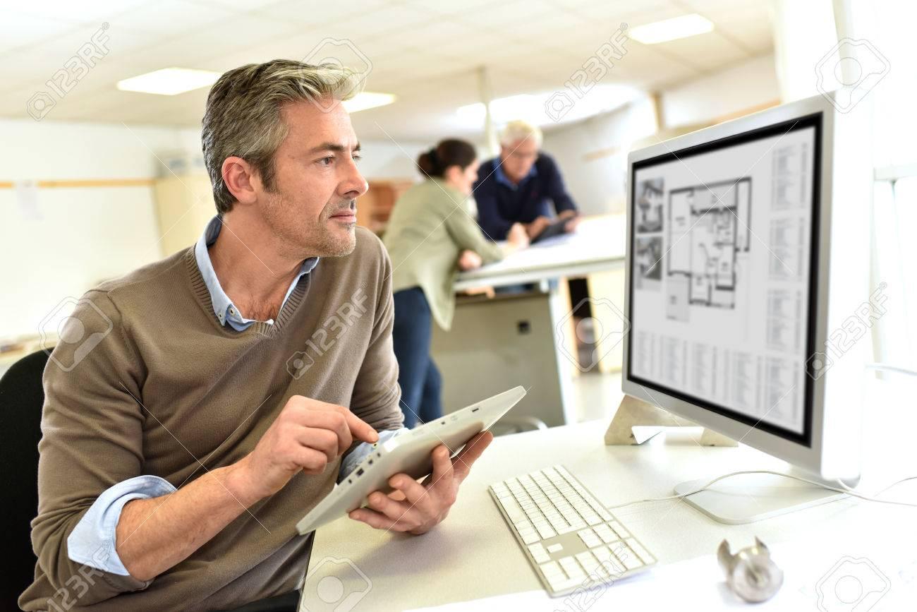 Engineer working in design office on desktop computer Standard-Bild - 50631092