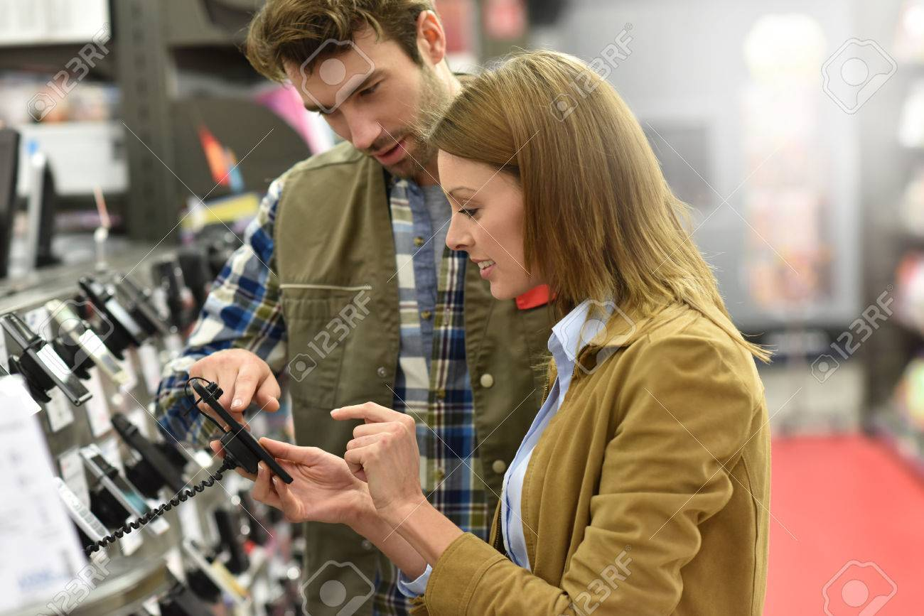Department store seller assisting customer with buying new phone Standard-Bild - 51881883