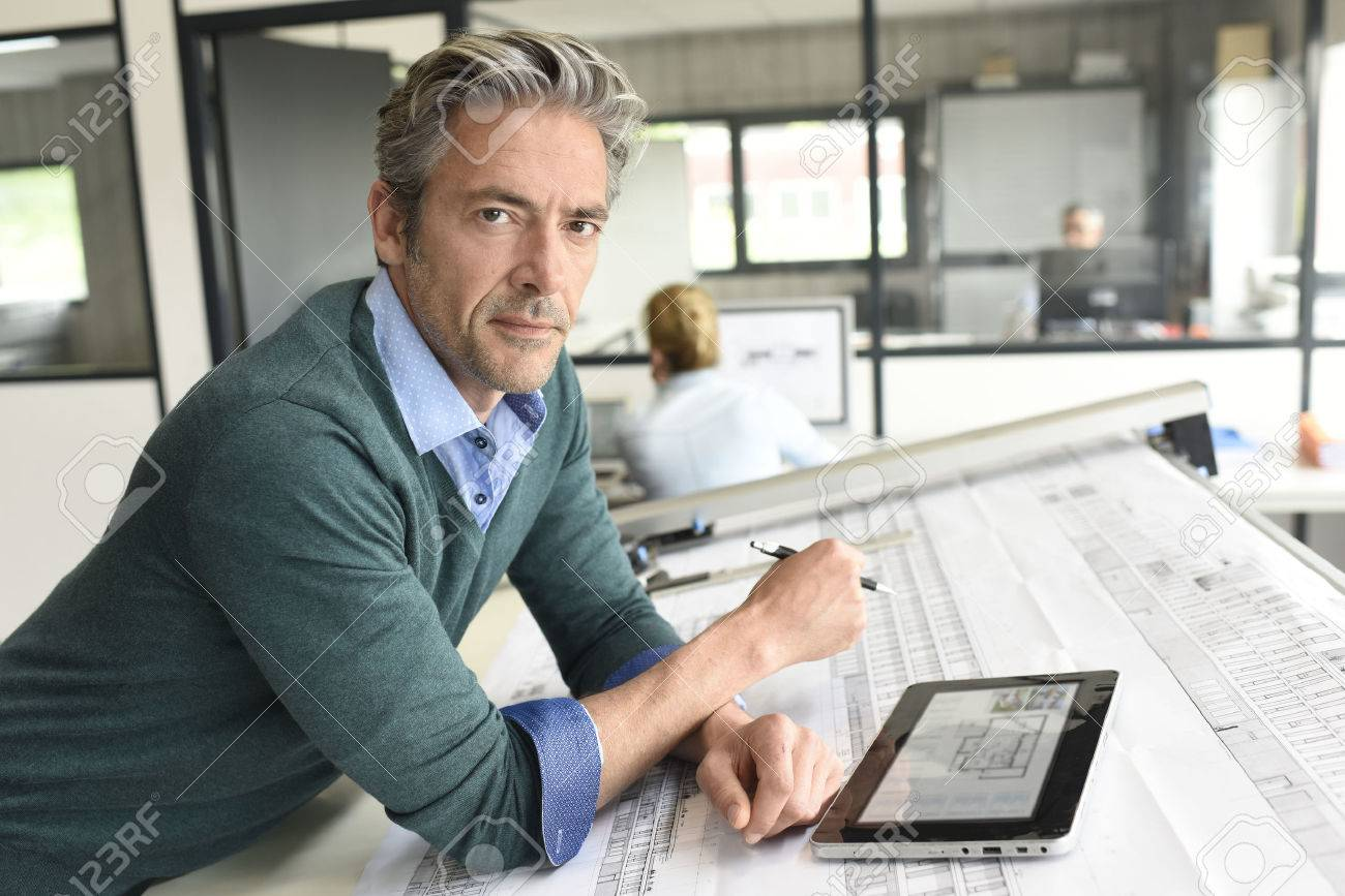 Architect working on project in office Standard-Bild - 57248921
