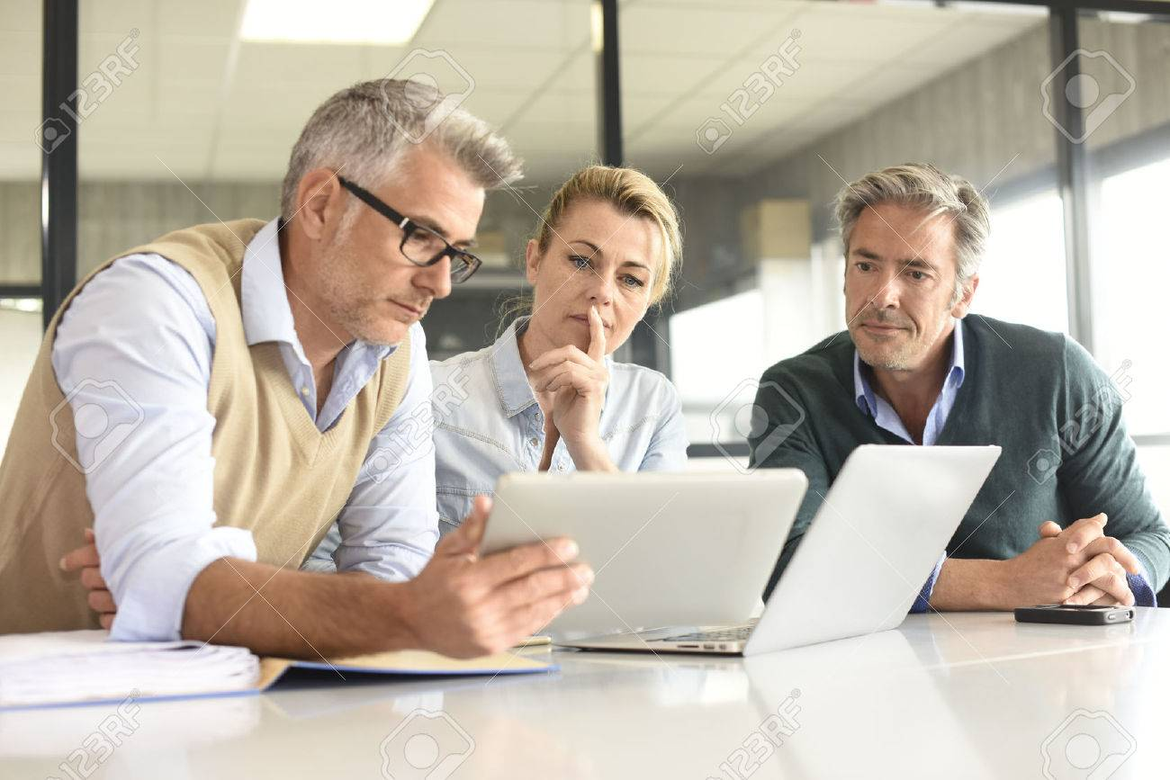 Business people in a meeting using tablet - 57177256