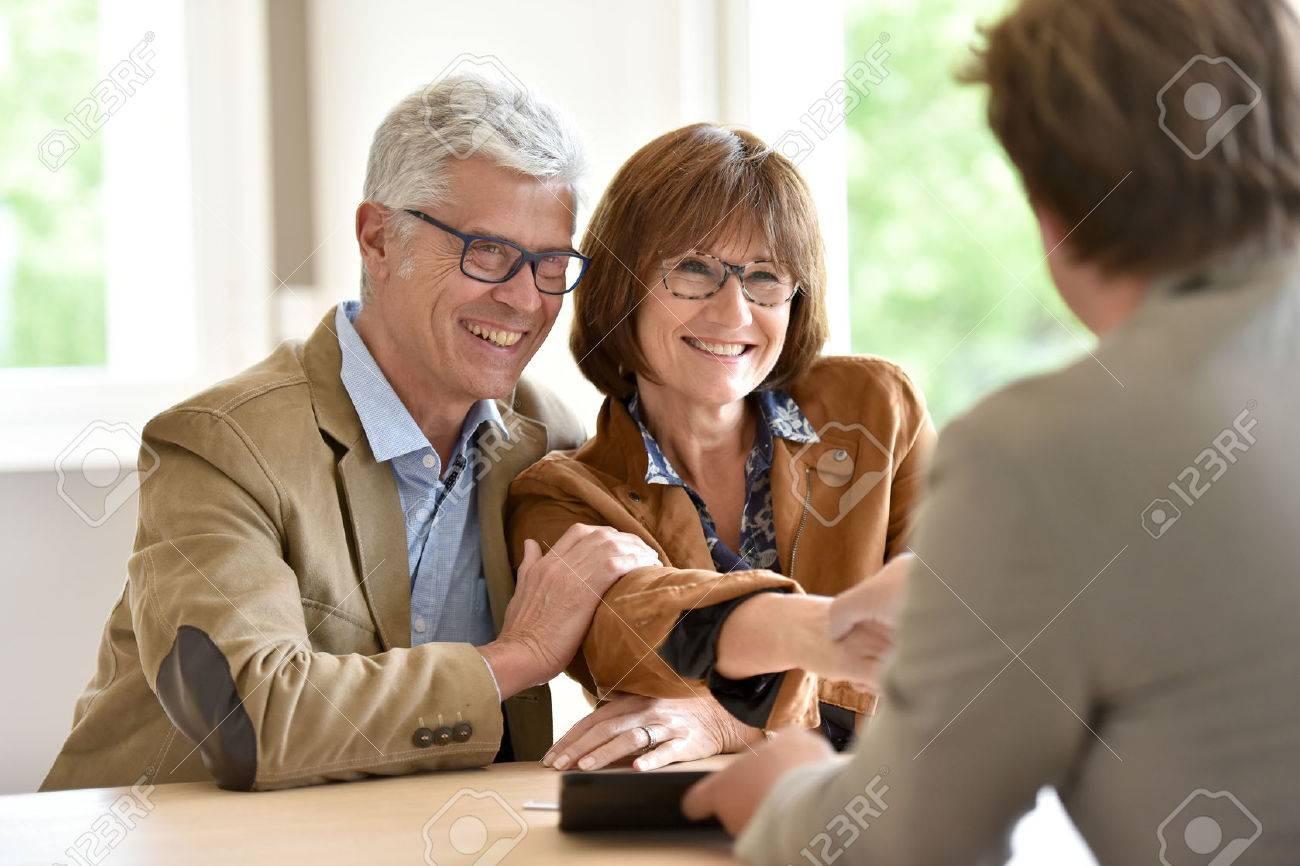 Senior couple meeting financial adviser for investment Standard-Bild - 58555087
