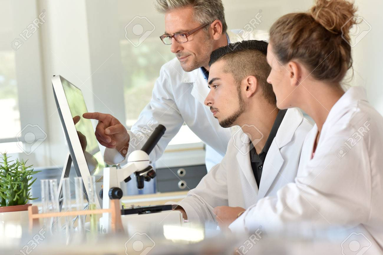 Students in biology attending training with microbiologist Standard-Bild - 62615934