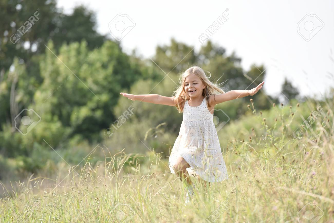 Little Girl Running In Country Field In Summer Stock Photo Picture And Royalty Free Image Image 65765360