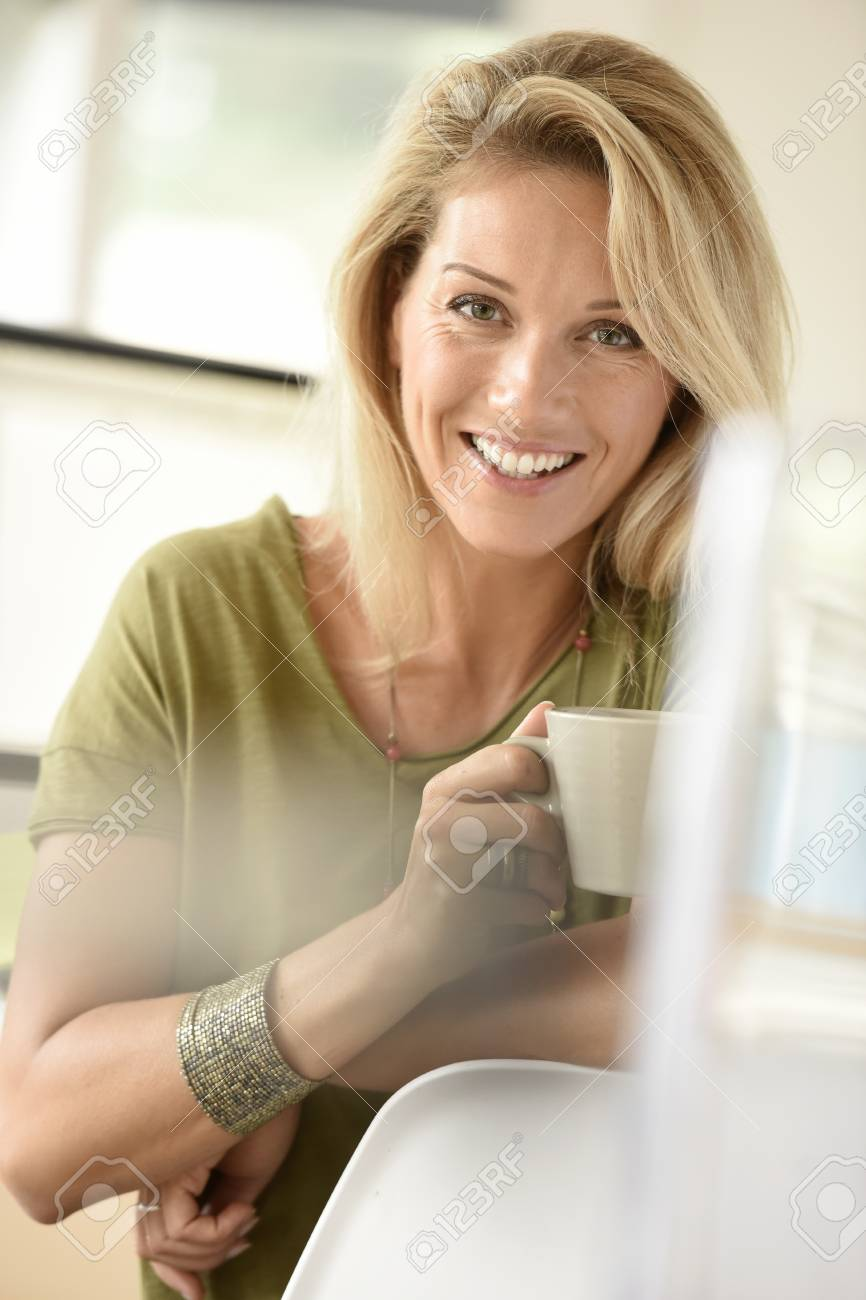 Blond hot women Attractive Blond Middle Aged Woman Dinking Hot Tea Stock Photo Picture And Royalty Free Image Image 65781923