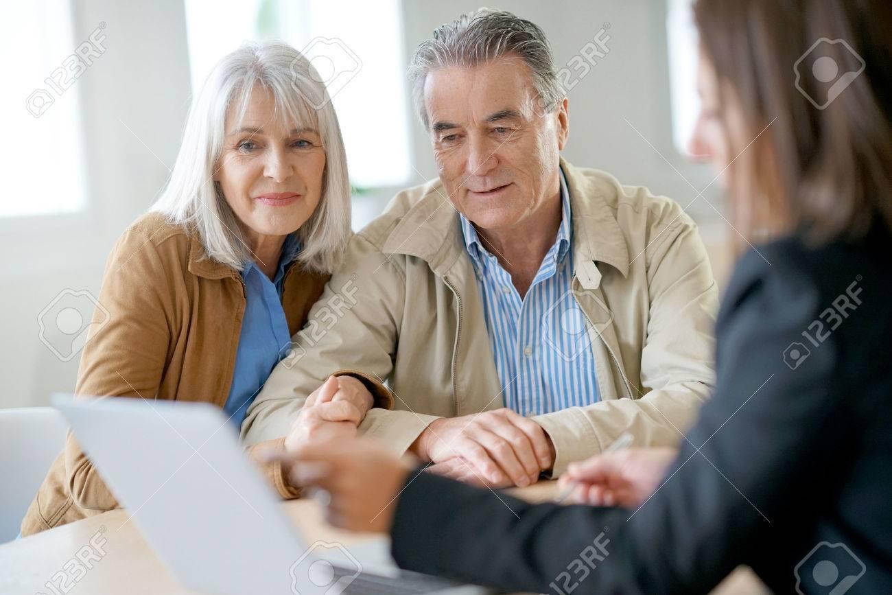 Senior couple meeting financial adviser for investment - 69227266