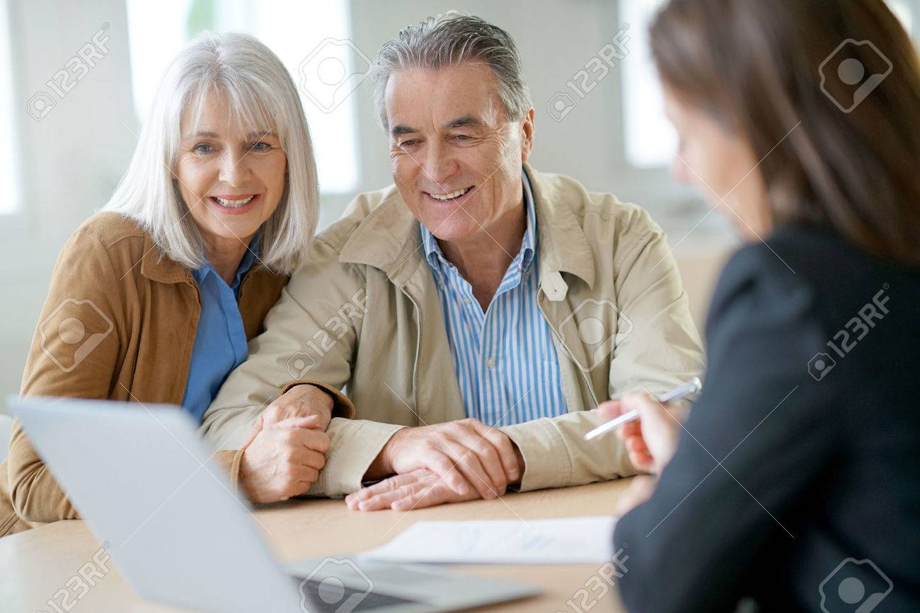Senior couple meeting financial adviser for investment - 69227267