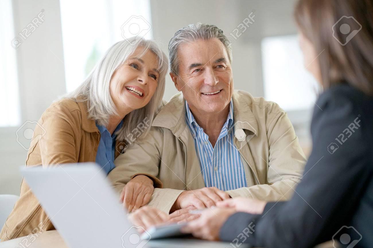 Senior couple meeting financial adviser for investment - 69227269